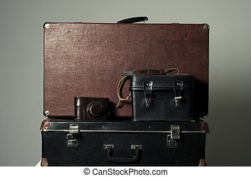 Background stack of old shabby suitcases and the camera....