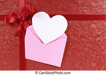 Red valentines day gift, white heart shape card, copy space