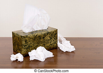 Box of tissues - Box of kleenex style tissues on a wood...