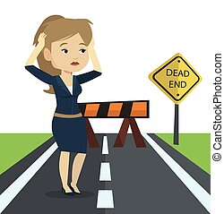 Business woman looking at road sign dead end. -...