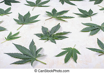 Abstract background with cannabis leaves over white woode...