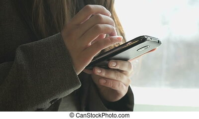Teenager looking information using mobile phone