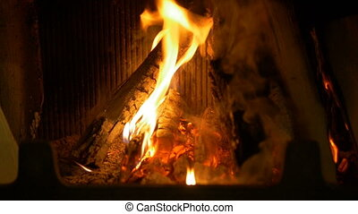 Wood burning in the fireplace. - Wood burning in the...