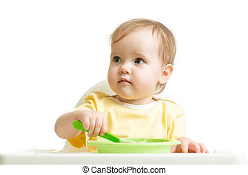 Baby girl eating yogurt or puree isolated on white background