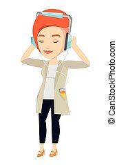 Young woman in headphones listening to music.
