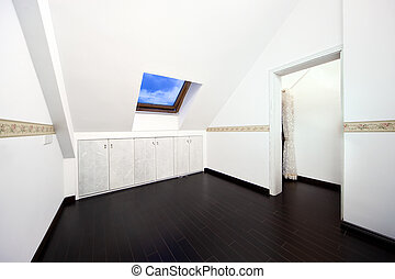 Attic room with roof skylight window - New modern attic room...