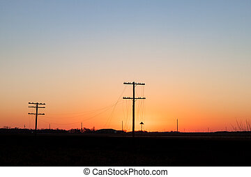 Telegraph Poles Silhouetted in Golden Sunrise - Two...