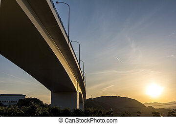 Viaduct at sunset - Viaduct under sky at sunset in...
