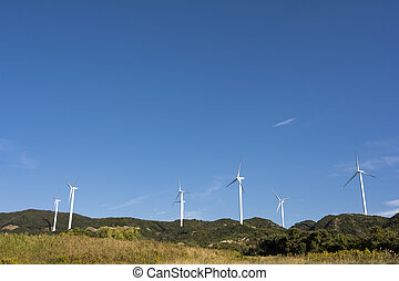 Wind power plant - Several wind power plants under blue sky