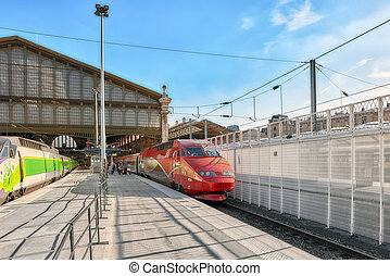 Modern speed passenger train on railways station Gare De...