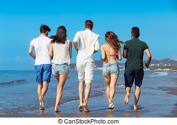 Friendship Freedom Beach Summer Holiday Concept - young people running