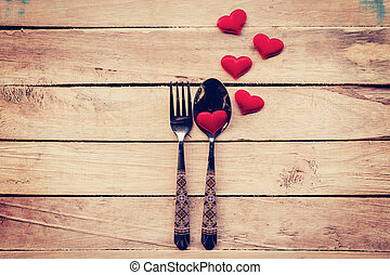 Table setting cutlery and red heart for dinner Valentine...