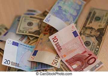 Cash on table isolated: dollars, euro broken money All in...
