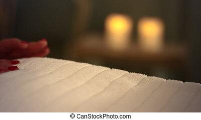 Gentle back massage - Back massage under a blanket with...