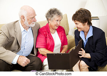 In-Home Sales Meeting - Senior couple listens to a sales...