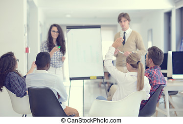 Businessman giving a presentation to his colleagues at work...