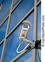 Security camera attached on business building with...