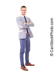 Smiling business man with crossed arms, isolated on white background