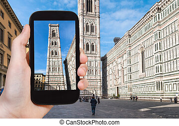 tourist photographs campanile in Florence - travel concept -...