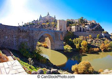 Alcantara bridge in Toledo with Alcazar on the background....