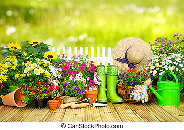 Gardening tools and flowers on the terrace i