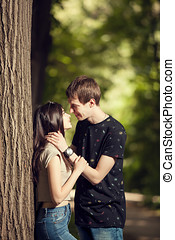 Cute couple kising in the park. Spending quality time...
