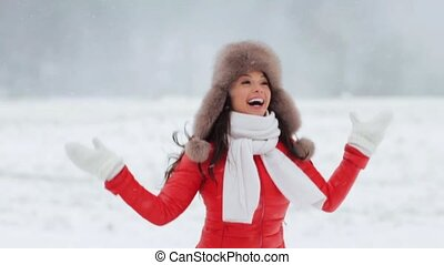 happy woman having fun outdoors in winter - people, season,...