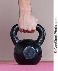 Black kettlebell ina gym