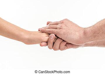 People holding hands - Two people holding hands for comfort...