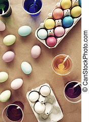 Shot of dyeing eggs at the table for Easter
