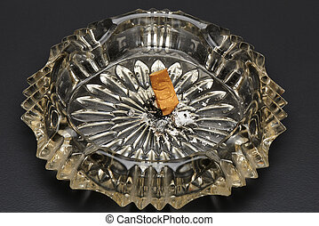 Give up smoking cigarette and crystal ashtray on table