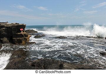 Sea waves splashing water