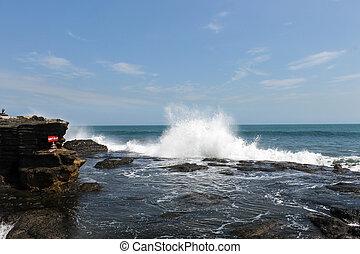 Ocean waves splashing water
