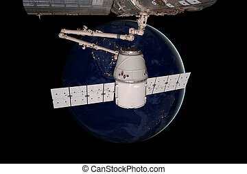 SpaceX Dragon orbiting the planet Earth. Elements of this...
