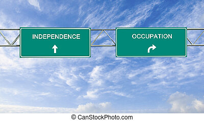 Road sign to independence and occupation