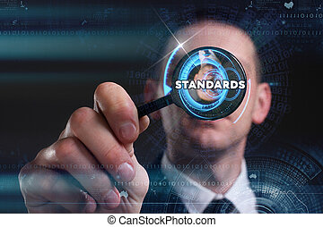 Business, Technology, Internet and network concept. Young businessman working on a virtual screen of the future and sees the inscription: standards