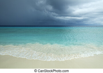 Tropical beach and strom clouds on Little Curaçao,...