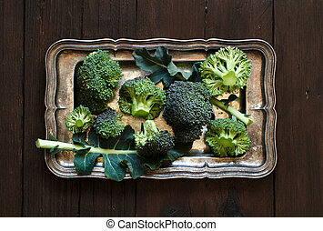 Fresh broccoli on old wooden table top view