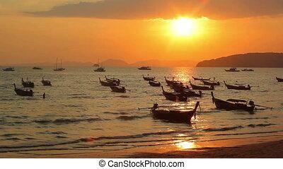 Longtail boats on seashore