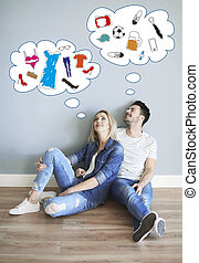 Picture of dreaming couple in their new flat