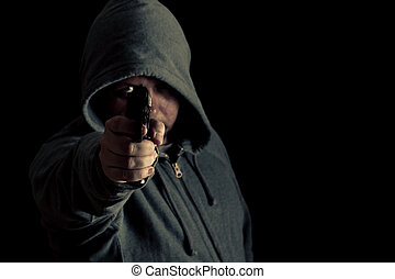 Thug in hoodie points gun - Man in green hoodie points gun