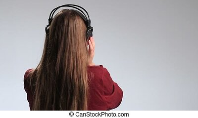 Party woman with headphones listening to music. -...