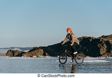 Girl on a bmx on ice. - The girl goes on a bmx on the...
