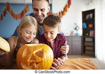 Happy family preparing to Halloween
