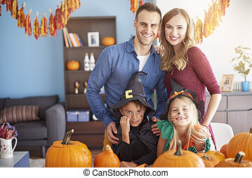 Family spending Halloween together at home