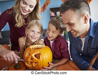 Family having fun together during halloween