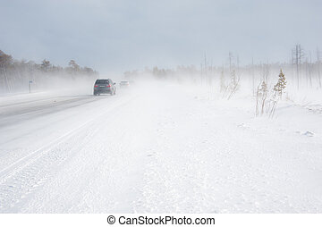 Winter driving during snow blizzard. - Cars on the winter...
