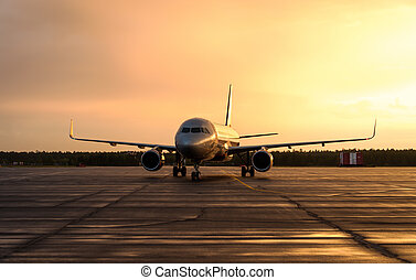 Airplane at sunrise - back lit. - Large commercial aircraft...
