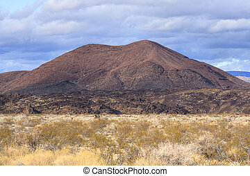 Volcanic cinder cone in Mojave desert of California - Dark...