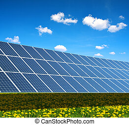 Solar power station on the spring flowering meadow....
